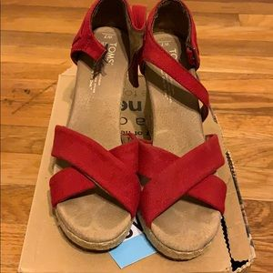 Red strappy wedge sandals